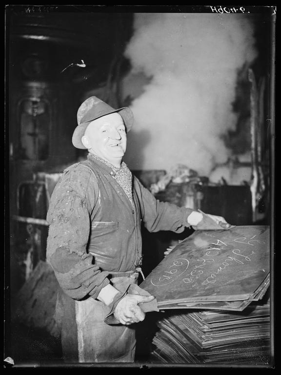 Tinplate worker       A photograph of a laughing tinplate worker in a South Wales factory
