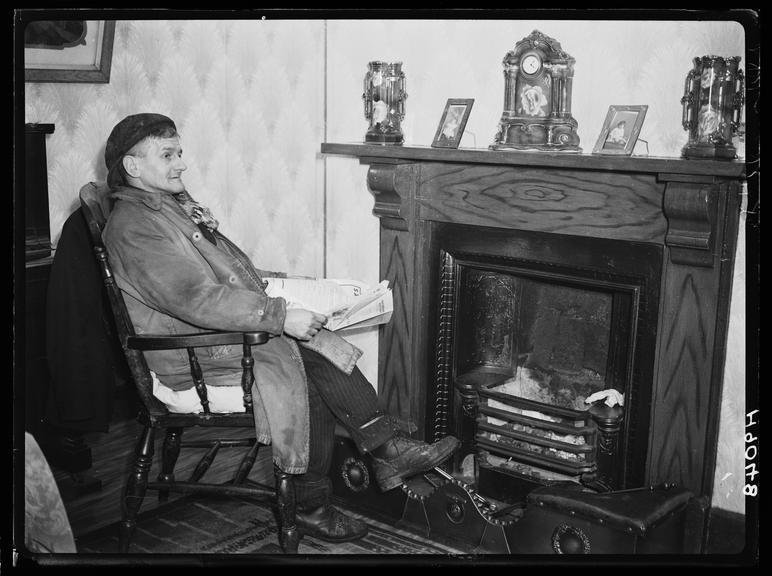 Welsh miner at home       A photograph of William, a South Wales miner, taken by Tomlin for the Daily Herald newspaper on 28 January, 1940