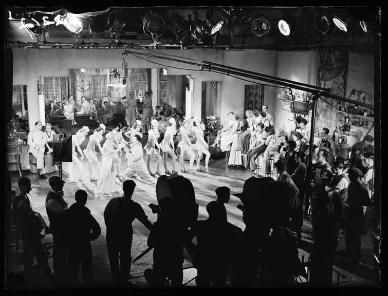 Filming 'I'll Stick to You'       A photograph of a film studio scene, taken by James Jarche (1891-1965) for the Daily Herald newspaper on 18 May, 1933