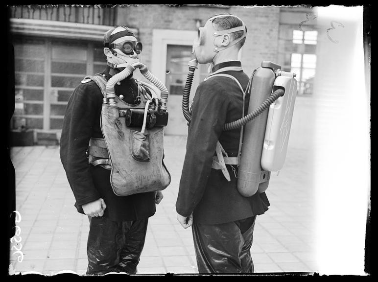 Firefighters in breathing equipment       A photograph of two firefighters wearing breathing equipment
