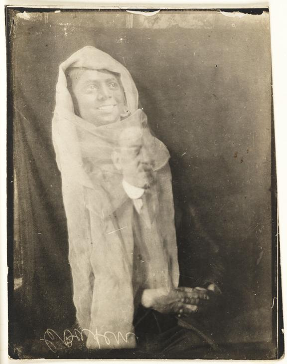 Man with a 'spirit' of his helper       A photograph of a middle aged man, taken by William Hope (1863-1933) in about 1920
