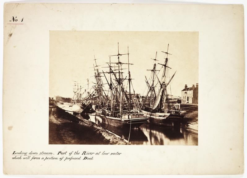 'Looking Downstream: Part of The River At Low Water...'       A photograph of sailing ships moored on the River Nene, in Wisbech