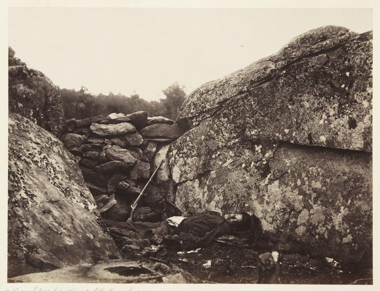 'Gettysburg - 3rd Day...'       A photograph of a dead soldier at Devil's Den on the battlefield at Gettysburg in Pennsylvania, America