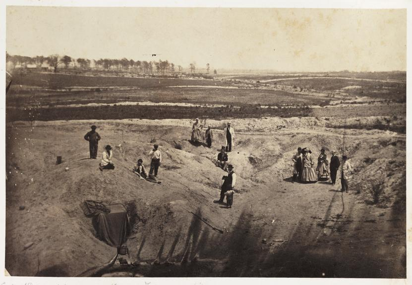 'Crater, Confederate Lines, Petersburgh Virginia'       A photograph of a group of tourists inspecting Confederate Army fortifications outside Petersburg in Virginia, America