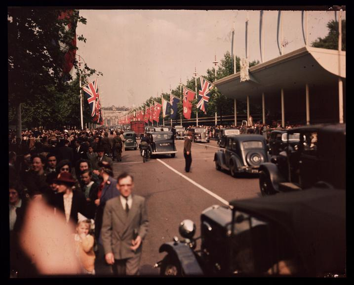 Crowds on the Mall       A Dufaycolor colour transparency of crowds on The Mall in London, taken by an unknown photographer in 1945