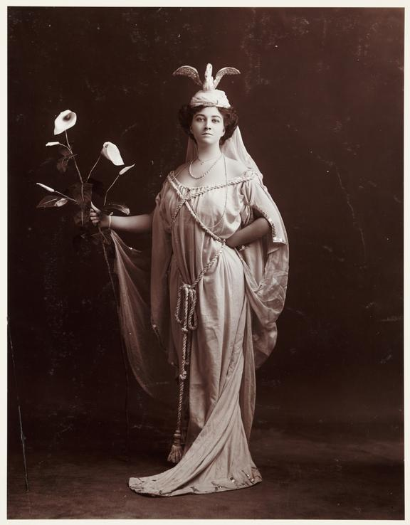 Woman in a classical costume       A photograph of a woman dressed in a classical-style costume with an elaborate headress