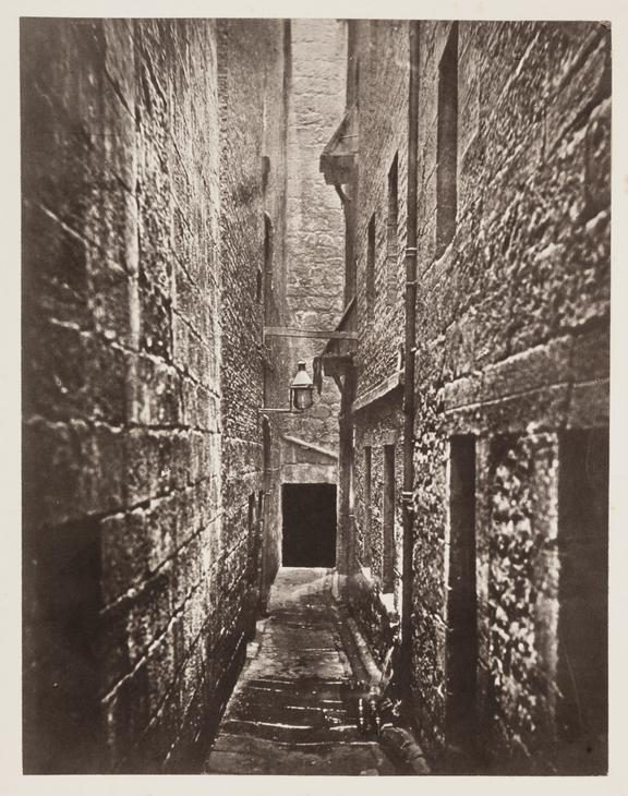 'Close, No.61 Saltmarket', 1868       A photograph of a narrow close behind No. 61 Saltmarket in Glasgow, taken by Thomas Annan (1829-1887), in 1868