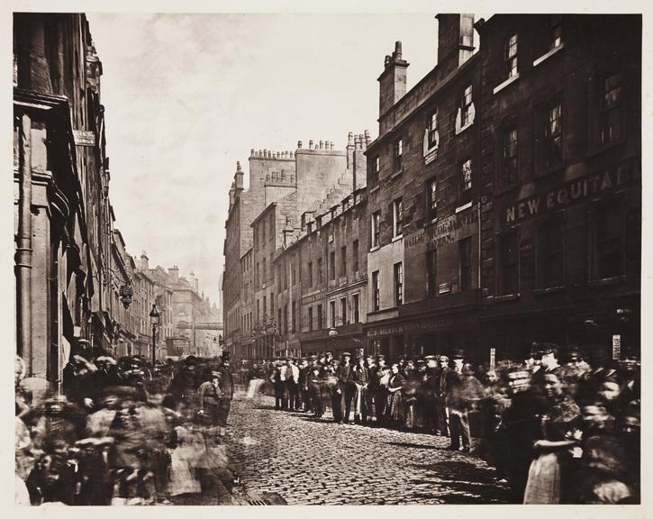 'Saltmarket, from Bridgegate', 1868       A photograph of bustling Saltmarket Street in Glasgow viewed from Bridgegate (or Briggait)