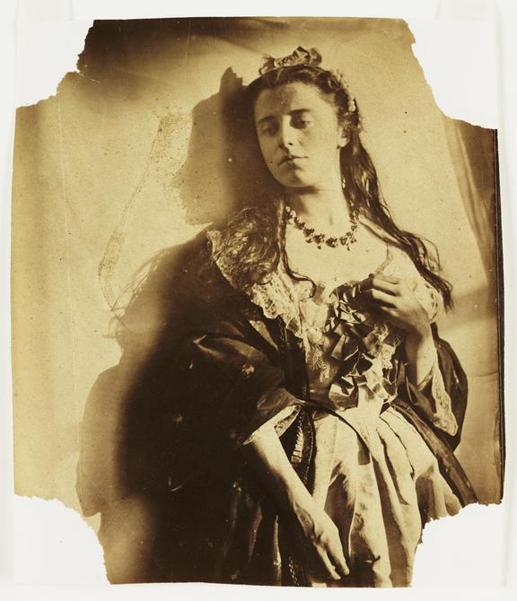 Woman leaning against a sunlit wall       A photograph of a young woman, possibly Isabella Hawarden (born 1846), taken by Clementina, Lady Hawarden (1822-1865)