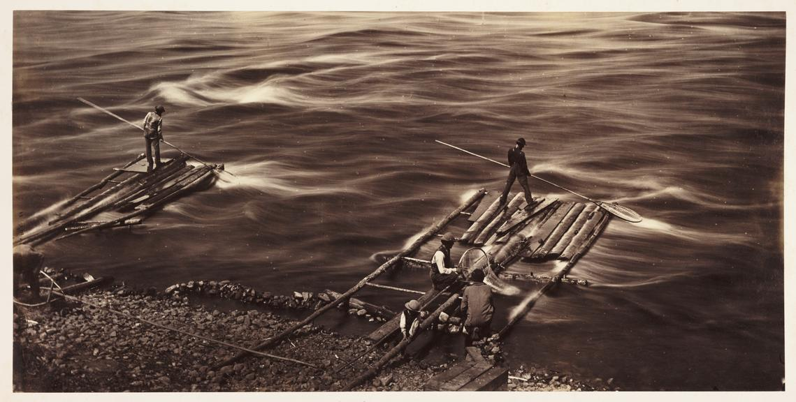 'Sault Recollet Ottawa River'       A photograph of men fishing from rafts at the edge of the Ottawa River near Sault au Recollet, in Quebec, Canada