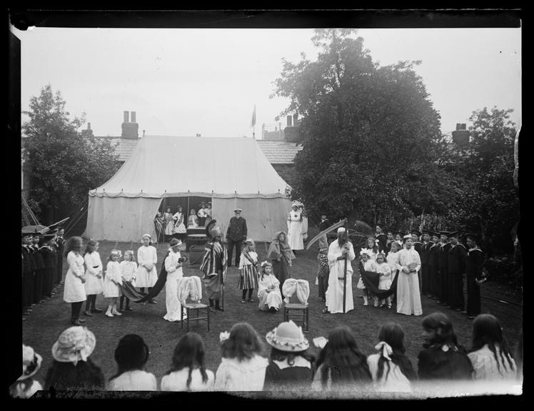 'Armistice Celebrations, 1919'       A photograph of a village's Armistice celebrations, taken by Edgar Tarry Adams (1852-1926), or his son
