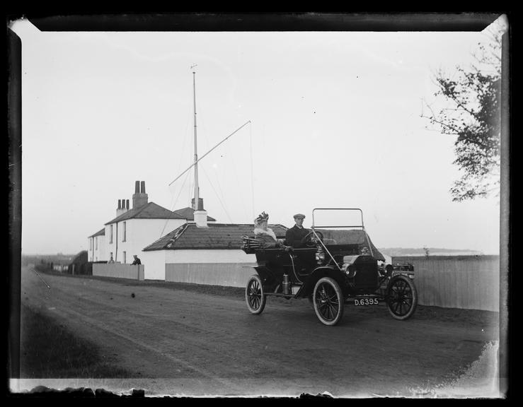 'Man And Woman In Ford Motor Car (Model 'T' Or 'N'), about 1910       A photograph of a man driving a Ford Motor Car, probably a 'Model T', introduced in 1908