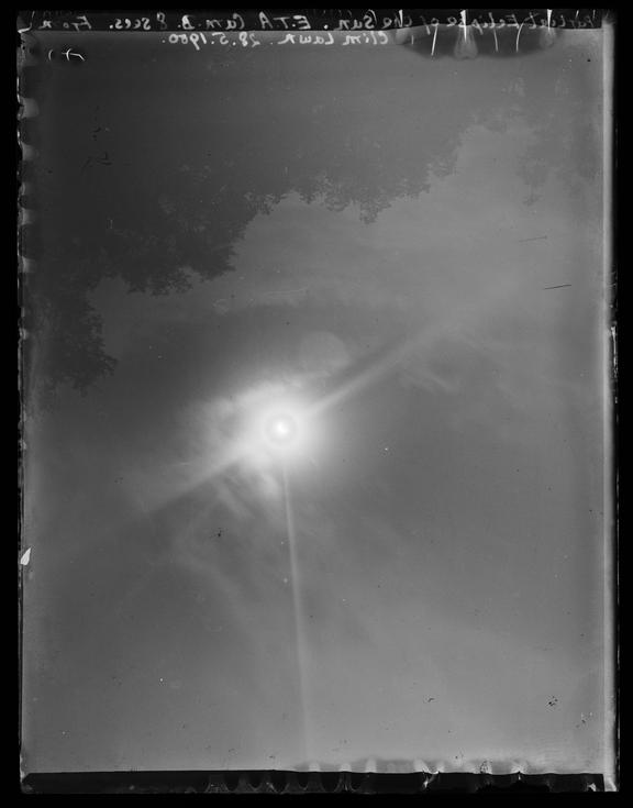 'Partial Eclipse Of The Sun. Taken From The Climatology Lawn'       A photograph of a partial eclipse of the sun, taken from the climatology lawn at Halstead Climatological Station