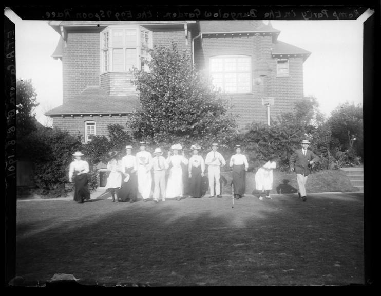 'Romp Party In The Bungalow Garden: The Egg And Spoon Race', 1901       A photograph of members of the Adams family having an egg and spoon race in the garden of their home in Deal, Kent