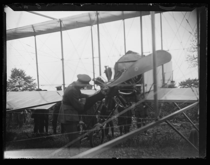 'Pilot Inspecting Aeroplane Propeller', about 1917       A photograph of a man inspecting the propeller of a plane, taken by Edgar Tarry Adams (1852-1926)