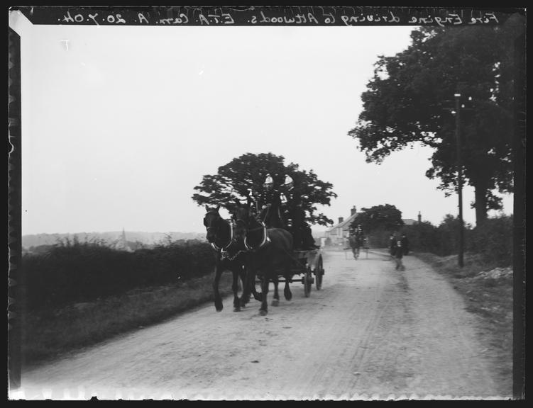 'Fire Engine Driving To Attwoods', 1904       A photograph of a horse-drawn fire engine driving towards Attwoods, in Halstead, Essex