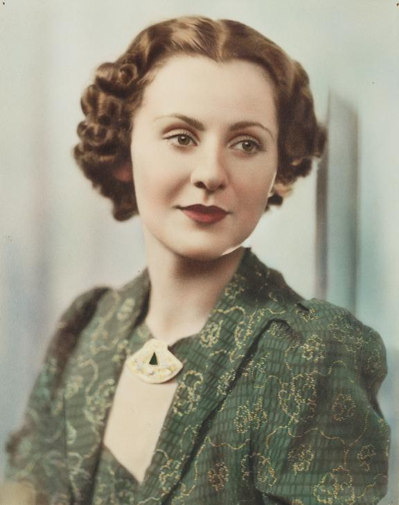 Portrait of a woman, 1943       A hand-coloured photographic portrait of a woman, taken by an unknown photographer in 1943