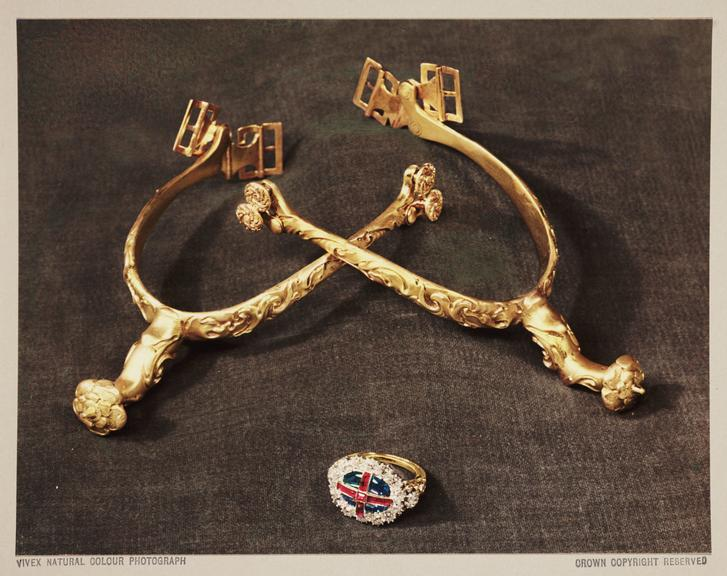 Golden Spurs and Coronation Ring, 1937       A Vivex colour photograph of a pair of golden spurs and  a Coronation Ring, part of the Bitish Crown Jewels