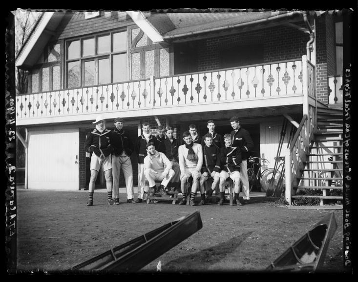 'Downing Boat House And Crews Of The Trial 'Eights'', 1900       A photograph of the boathouse of Downing College, Cambridge University with a group of college rowers