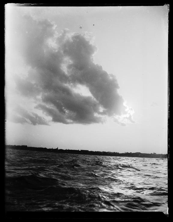 'View Of Clouds/Storm Breaking Over Deal, Taken From A Boat', about 1899       A photograph of storm clouds above the coastline of Deal in Kent, taken by Edgar Tarry Adams (1852-1926), in about 1899