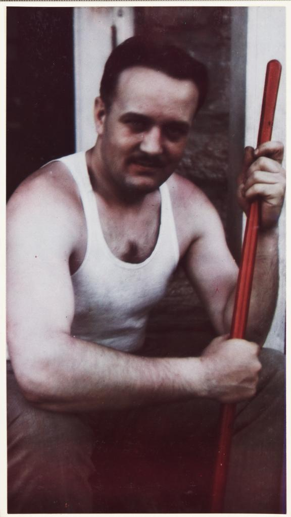 Man in vest       A colour photograph of a man wearing a vest