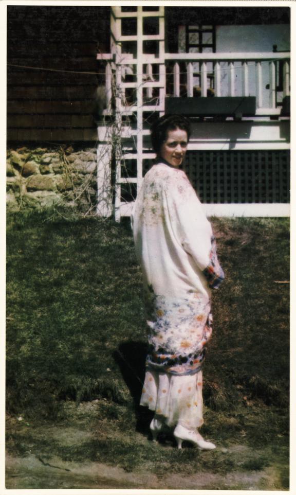 Woman in a long dress       A colour photograph of a woman wearing an elegant long dress