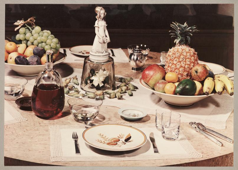 Table setting       A Vivex colour photograph of a table setting with bowls of fruit, taken by an unknown photographer in about 1935