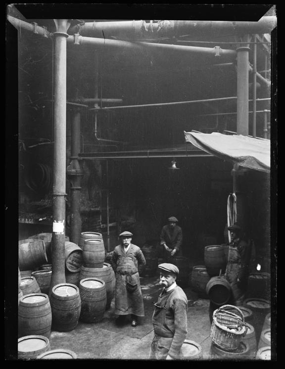'Men At Work In The London Brewery', about 1900       A photograph of a group of brewery workers,  taken by Edgar Tarry Adams (1852-1926), in about 1900