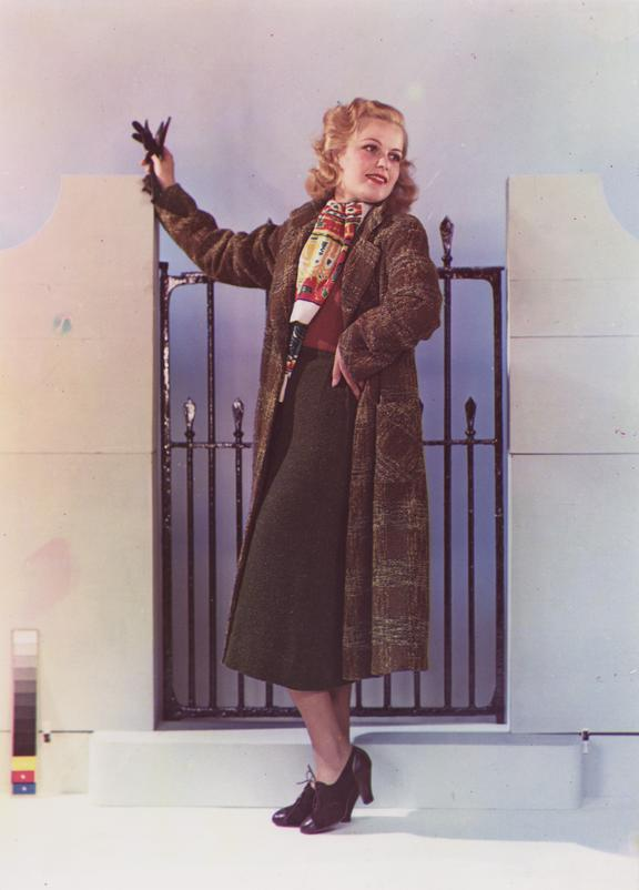 Fashion photograph       A Dye Transfer colour photograph of a woman modelling a coat, taken by an unknown photographer in about 1940