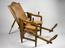 Parturition chair, German, 18th century.       Full view, chair leaning back with rest.        Grey background.