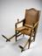 Parturition chair, German, 18th century.       Full 3/4 view, grey background.