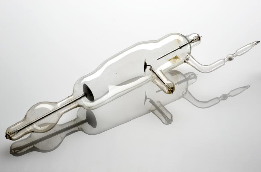 Potash regulated X-ray tube, c.1897.       Full view, white perspex background with reflection.