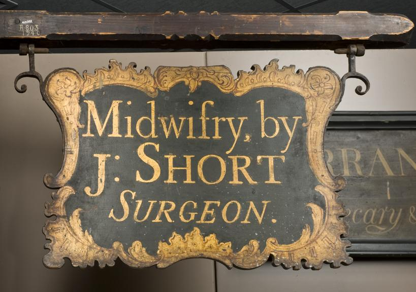 Surgeon's signboard, wooden, suspended from beam, English, 18th century.       Full view, on gallery image.