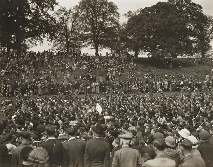 The Kent rally of Out Door Folk       at Mote Park, Maidstone. The caption reads 'The crowd listening to the Health Minister Sir Hilton Young'.