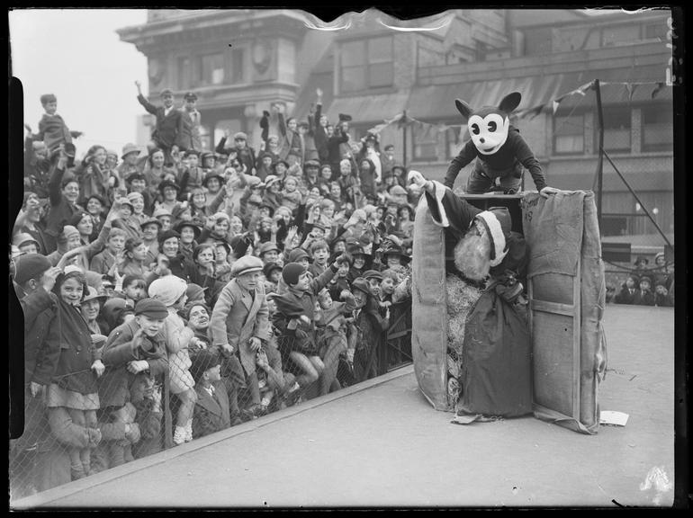 'Father Christmas arrives at Selfridges by parcel post, with Mickey Mouse'