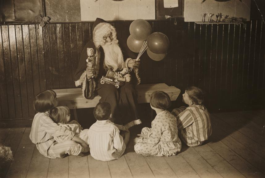 'Father Christmas with kiddies'       A photograph entitled 'Father Christmas with the kiddies', taken in 1932 by James Jarché for the Daily Herald