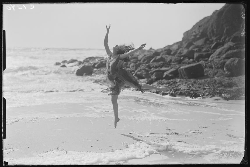 'Miss Phyllis Fildes dancing on the beach, Porthgwarra, Cornwall'       A photograph of Miss Phyllis Fildes dancing on the beach at Porthgwarra, Cornwall