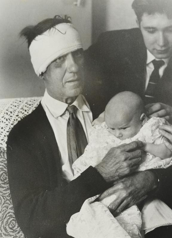 'Train driver, Jack Mills, with his grandchild, Stephen'       Jack Mills was the driver of the train involved in the Great Train Robbery.