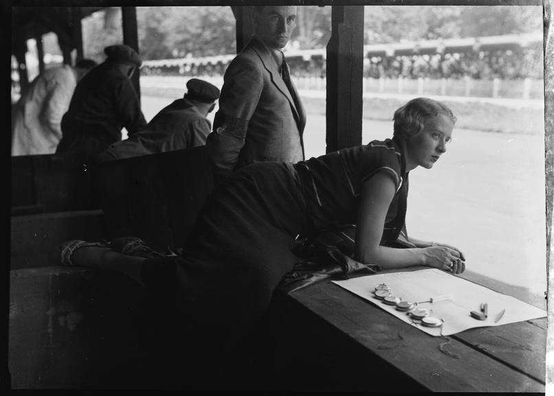 Female timekeeper looks out over AVUS race track, Berlin
