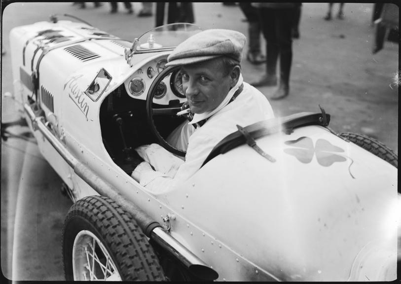 Robert 'Bobby' Kohlrausch at wheel of Austin single seater racing car, Berlin