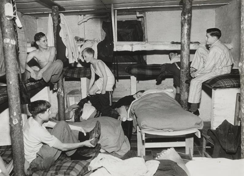 Evacuees in shelter       A photograph of evacuees going to bed in an air raid shelter
