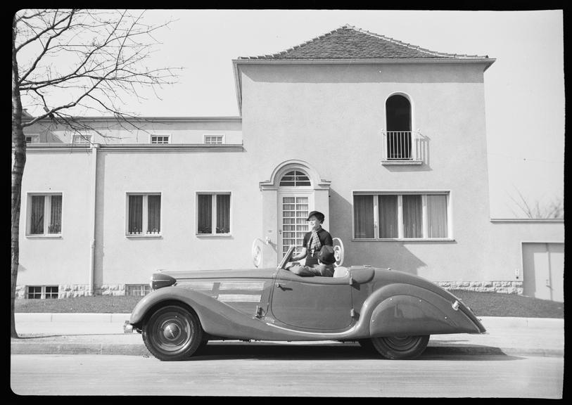Couple in an Opel 6 cylinder roadster motor car, Germany
