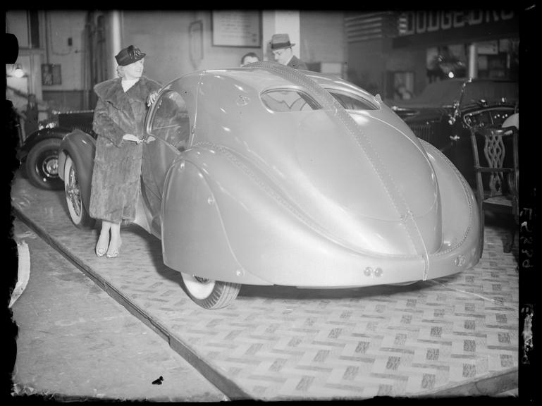 Streamlined car on display at a motor exhibition, Olympia ...