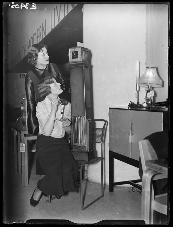 Modern Living Exhibition at Whiteley's       A photograph of two women at the 'Modern Living Exhibition' at Whiteley's Stores in London, taken in 1935
