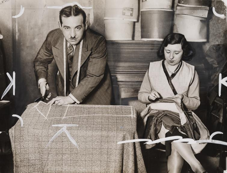 A tailor and his assistant at work       A photograph of a tailor and his assistant, taken in March 1930 by Leslie Cardew for the Daily Herald