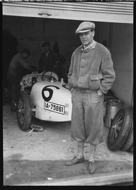 Hans Joachim von Morgen with a Bugatti Type 35 racing car behind, Nurburgring