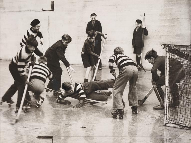 Roller skating hockey league       A photograph of a roller skating hockey league, taken in February 1939 by Sayers for the Daily Herald