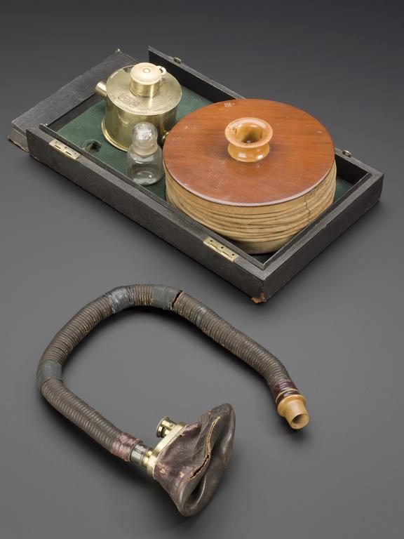Clover chloroform inhaler with case lacking lid, by Coxeter, London, 1862-1894.  Overhead view of whole object against