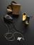 Medresco portable hearing aid, by Remploy Ltd., England, 1953. 3/4 top view. Black graduated background