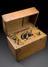 Diathermy set, British, c.1930, in oak case.       Full view, graduated black background.